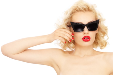 Young beautiful stylish blond woman in vintage sunglasses, over white background photo