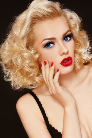 Young beautiful stylish retro blond girl with surprised expression photo