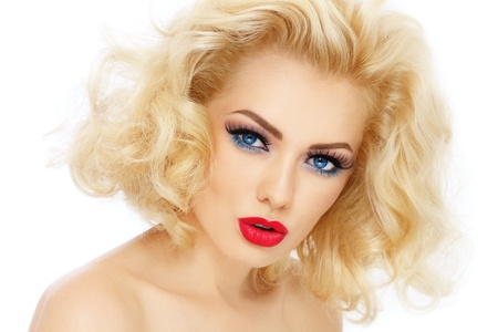 Young beautiful woman with blond curly hair and stylish make-up, over white background photo