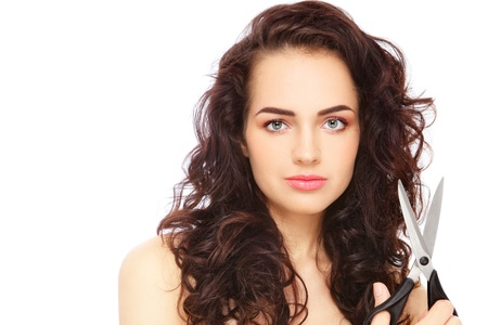 Young beautiful woman with long curly hair and scissors in her hand, on white background Stock Photo - 14642406