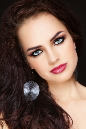 Close-up portrait of young beautiful woman with long curly hair and stylish make-up Stock Photo - 14642418