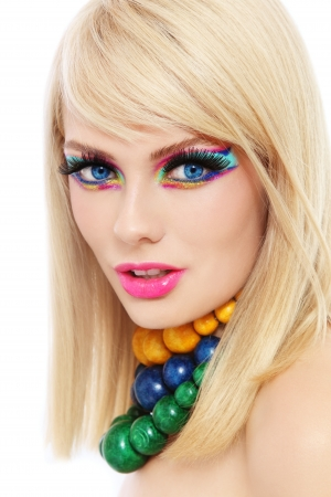 Young beautiful  blond woman with fancy make-up and colorful wooden necklaces photo