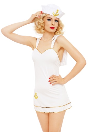seductive expression: Young beautiful slim sexy girl with blond curly hair and stylish make-up dressed as sailor, over white background