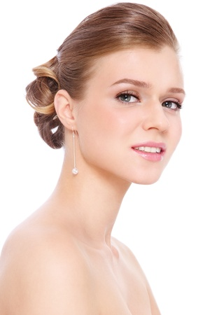 Young beautiful blond girl with prom make-up and hairdo, over white background
