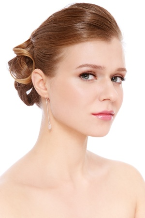 Young beautiful blond girl with prom make-up and hairdo, over white background photo