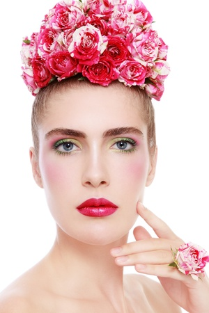 Young beautiful fresh woman with bright make-up and flowers in her hair, on white background Stock Photo - 14642402
