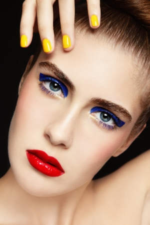 Close-up portrait of young beautiful woman with colorful fancy make-up and manicure Stock Photo - 14642413