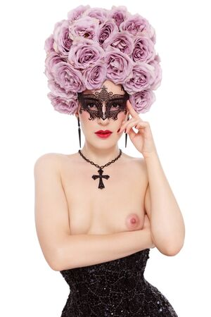 Young beautiful slim sexy woman in corset with fancy wig of roses on her head and mask over white background Stock Photo - 15032580