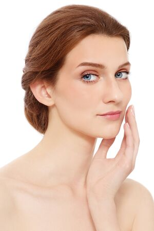 Portrait of young beautiful healthy woman touching her face, on white background Stock Photo - 15032585