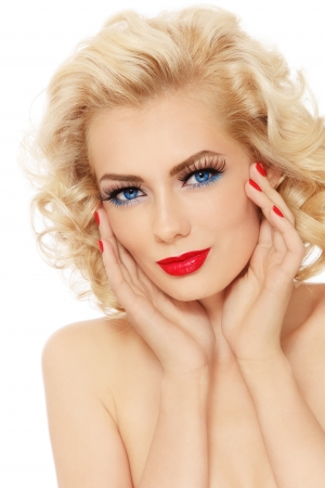 Young beautiful sexy blonde with stylish make-up and hairdo touching her face, on white background photo