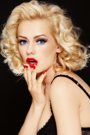 pin up: Young beautiful stylish retro blond girl with surprised expression Stock Photo