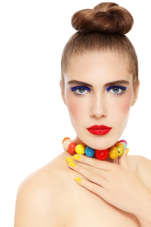 Young beautiful woman with fancy make-up and colorful necklace over white background Stock Photo - 15032576