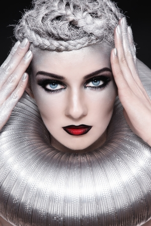 Portrait of young beautiful woman with stylish fancy make-up and silver hair photo