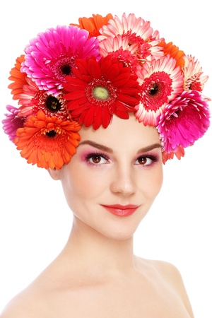 Young beautiful woman with fresh make-up and colorful gerberas on her head, over white background Stock Photo - 15278789