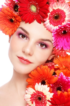 Portrait ofyoung beautiful woman with fresh make-up and colorful gerberas in her hair, on white background Stock Photo - 15278850