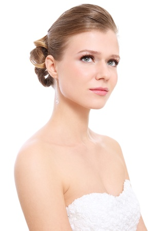 Young beautiful bride with stylish make-up and hairdo, over white background photo