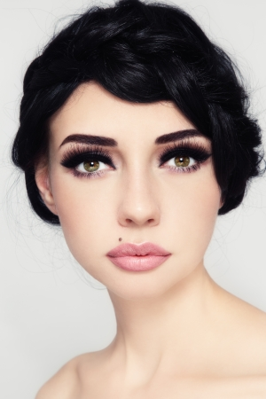 Portrait of young beautiful woman with stylish make-up and hairdo photo