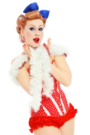 female christmas: Young beautiful sexy happy excited pin-up girl in red corset, over white background