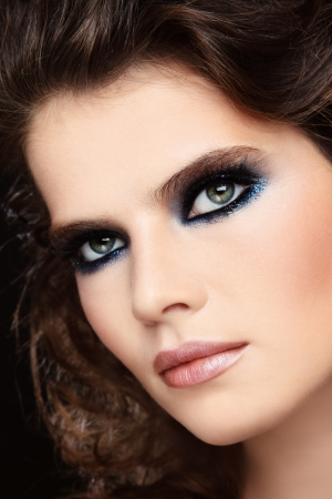 Close-up portrait of young beautiful woman with stylish glamorous make-up Stock Photo - 15973527