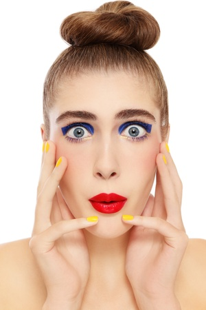 Portrait of young beautiful woman with colorful fancy make-up and shocked expression, on white background photo