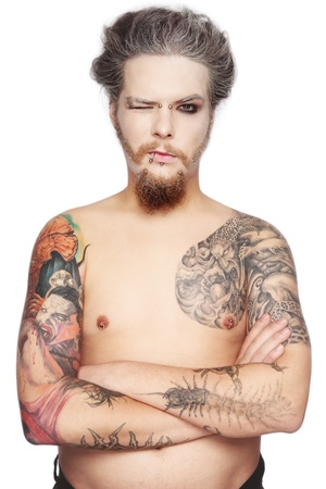 modifying: Man with tattoos and piercing over white background