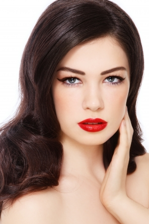 Portrait of young beautiful woman with curly hairstyle and red lipstick, on white background photo