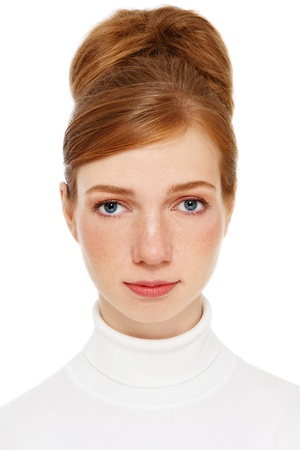 Young freckled girl with vintage hair bun, over white background photo