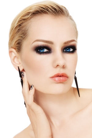 smoky eyes: Portrait of young beautiful woman with smoky eyes, on white background