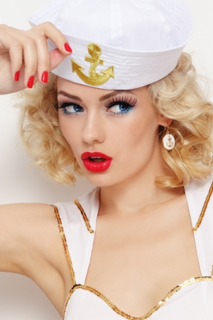 sailor girl: Young beautiful sexy girl with blond curly hair and stylish make-up dressed as sailor