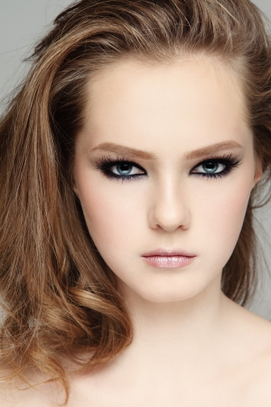 Portrait of young beautiful girl with smoky eyes