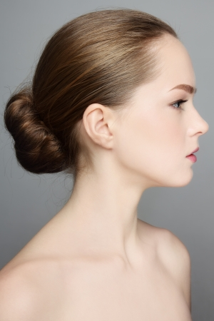 Profile portrait of young beautiful girl with hair bun Stock Photo - 16711478