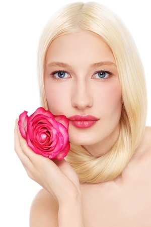 bleached: Portrait of young beautiful fresh blond woman with pink rose in her hand, on white background Stock Photo