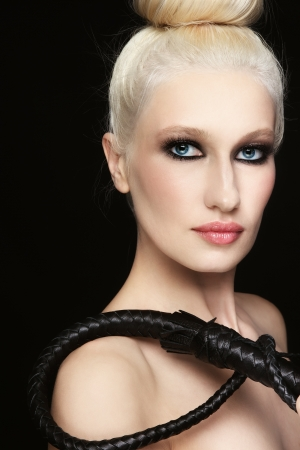 bondage girl: Young beautiful blond woman with braided bull whip in her hand Stock Photo