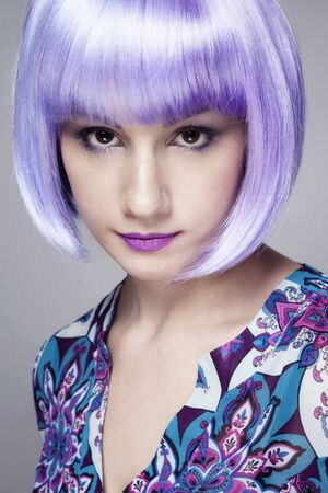 Young pretty woman in fancy violet wig Stock Photo - 17104315