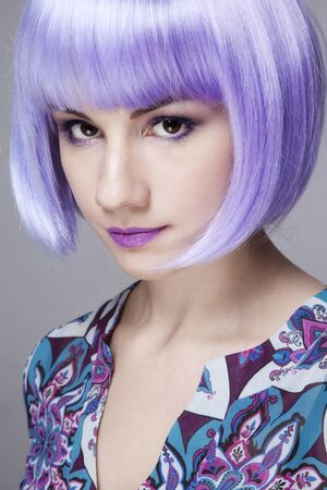 Young pretty woman in fancy violet wig Stock Photo - 17130051