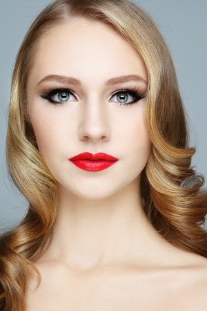 Portrait of young beautiful girl with red lipstick and stylish hairdo Stock Photo - 17104313