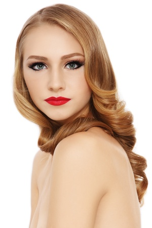 Young beautiful girl with long curly blond hair and stylish make-up, on white background Stock Photo - 17104303