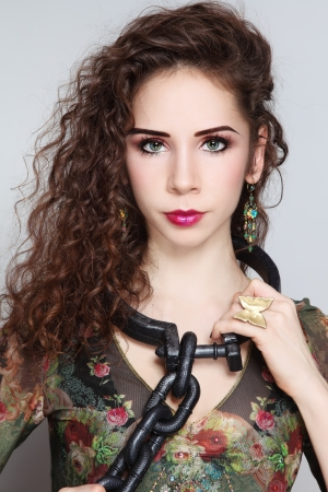 woman handcuffs: Portrait of young beautiful woman with heavy chain on her neck