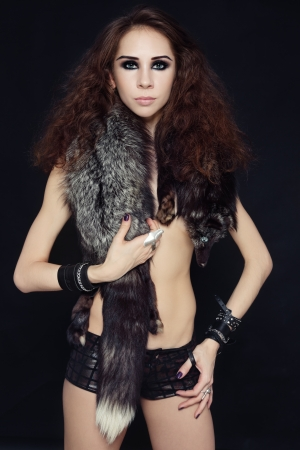 Young beautiful slim sexy woman with fur boa Stock Photo - 17076352