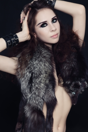 entice: Young beautiful slim sexy woman with fur boa  Stock Photo