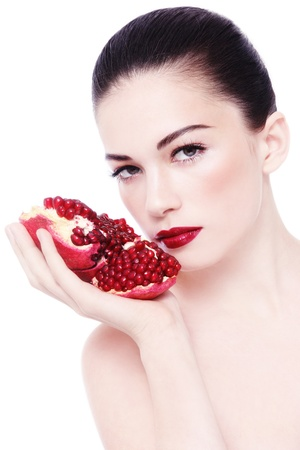 Portrait of young beautiful woman with pomegranates in her hands, on white background Stock Photo - 17478157