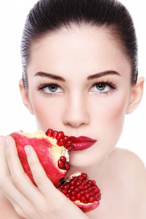 Portrait of young beautiful woman with pomegranates in her hands, on white background Stock Photo - 17478145