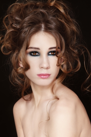 Portrait of young beautiful fresh girl with fancy fancy ake-up and hairdo Stock Photo - 17478155