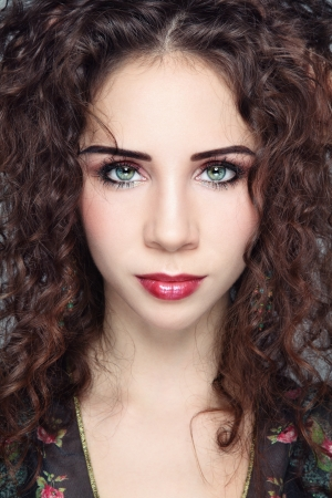 Close-up portrait of young beautiful woman with curly hair and fancy make-up Stock Photo - 17478131