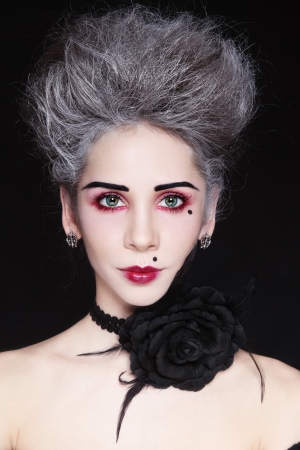 goth girl: Young beautiful woman with vintage make-up and hairdo