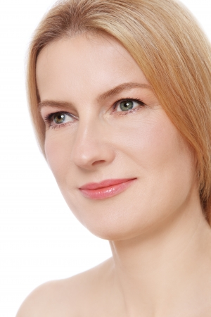 looking upwards: Close-up portrait of beautiful mature woman with clear skin looking upwards, on white background Stock Photo