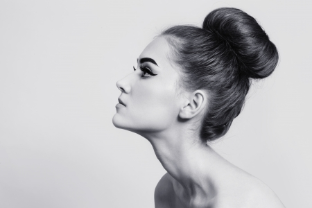 buns: Black and white shot of young beautiful girl with hair bun