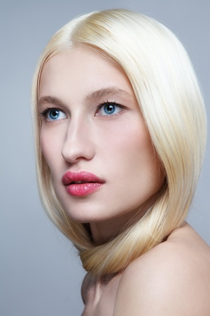 Portrait of young beautiful fresh woman with long bleached hair and clear make-up looking upwards Stock Photo - 19550115