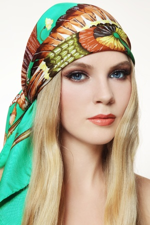 kerchief: Portrait of young beautiful woman with stylish make-up and colorful scarf on her head