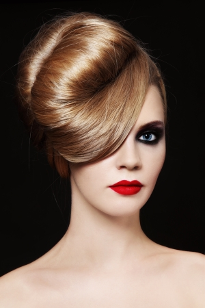 smoky eyes: Young beautiful woman with fancy hairdo and smoky eyes
